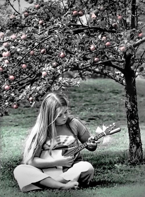 Under the apple tree –                 Eva playing the balalaika