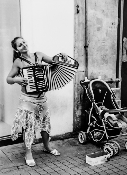 Street musician with baby